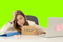 Young attractive sad and desperate businesswoman suffering stress at office laptop computer desk green croma key background royalty free stock images