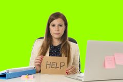 Young attractive sad and desperate businesswoman suffering stress at office laptop computer desk green croma key background. Young attractive sad and desperate Stock Photo