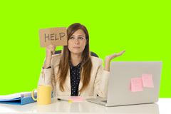 Young attractive sad and desperate businesswoman suffering stress at office laptop computer desk green croma key background stock photography