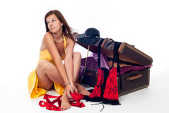 Young attractive sad woman near old suitcase Stock Photos