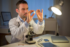 Young attractive scientist working late at office Royalty Free Stock Image