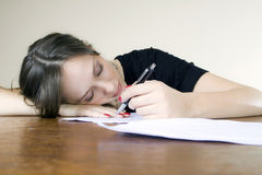 Young attractive secretary asleep at her desktop Royalty Free Stock Photography