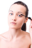 Young attractive sensual woman is applying mascara Royalty Free Stock Photos