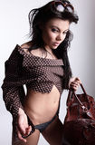 Young attractive sexy girl posing with bag Stock Photography