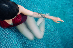 Young attractive woman in pool Stock Photo
