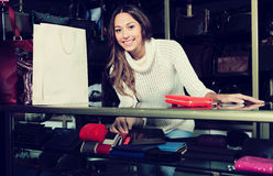 Young attractive shopgirl in haberdashery shop Stock Image