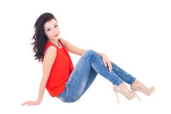 Young attractive slim woman sitting isolated on white Royalty Free Stock Photography