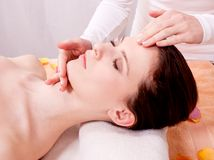 Young attractive smilig woman doing wellness spa. Relaxing massage stock image
