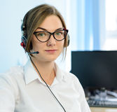 Young Attractive Smiling Customer Support Phone Operator with Headset in Office. Stock Images