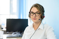 Young Attractive Smiling Customer Support Phone Operator with Headset in Office. Stock Image