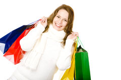 Young attractive smiling woman after shopping tour Royalty Free Stock Photos