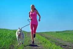 Young Attractive Sport Girl Running With Dog In Park Royalty Free Stock Photos