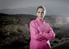 Young attractive sport woman in running jacket posing with attitude defiant cool Royalty Free Stock Image