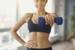 Young sportswoman doing fitness exercises at sport gym stock photos