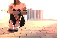 Free Young Attractive Sporty Girl Resting On The Street With Mobile Phone And Music, Outdoor At Sunset Or Sunrise In City. Royalty Free Stock Photography - 125723777