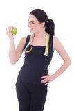 Young attractive sporty woman with apple and measuring tape isol Stock Photos
