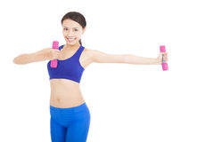 Young attractive sporty woman with dumbbells Stock Image