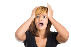Young attractive stressed out lady going crazy putting her hands on head Stock Images