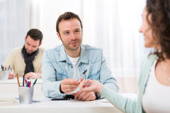 Free Young Attractive Student Lend A Pen To Classmate Stock Photo - 51719000