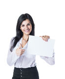 Young, attractive, successful business woman showing  card and thumbs up Royalty Free Stock Images