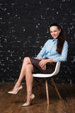 Young, attractive, successful business woman, sitting on a chair. stock photography