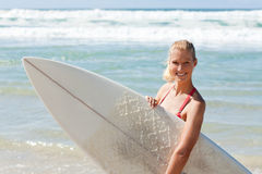 Young Attractive Surfer Holds A Board On The Beach Stock Photography