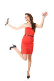 Young attractive surprised female in red dress Royalty Free Stock Image