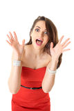 Young attractive surprised female in red dress Stock Photos
