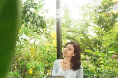Young attractive sweet girl with notepad on a veranda. Spring mo. Od Royalty Free Stock Photo