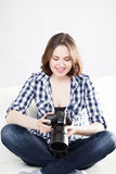 Young and attractive teenage girl with a dslr camera Stock Photos