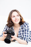 Young and attractive teenage girl with a dslr camera Stock Photography