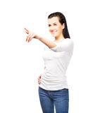 Young and attractive teenage girl pressing imaginary button Stock Photos