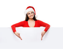Young and attractive teenager girl with a blank billboard Royalty Free Stock Image