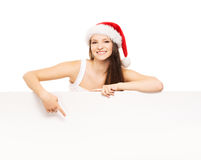 Young and attractive teenager girl with a blank billboard Royalty Free Stock Photos