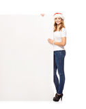 Young and attractive teenager girl with a blank billboard Stock Photos