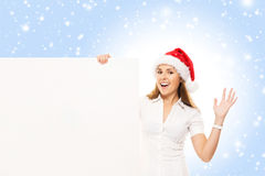 Young and attractive teenager girl with a blank billboard Stock Image