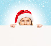 Young and attractive teenager girl with a blank billboard Stock Photo