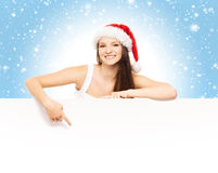 Young and attractive teenager girl with a blank billboard Royalty Free Stock Photography