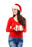 Young and attractive teenager girl with a Christmas present Royalty Free Stock Photography