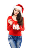 Young and attractive teenager girl with a Christmas present Stock Photos