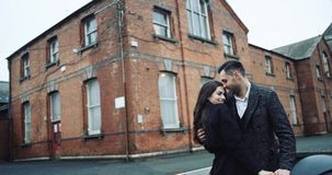 Young attractive tourist couple embracing and kissing in a romantic destination city, enjoying each other company and stock video
