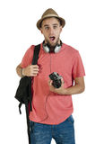 Young attractive tourist guy with camera and headphones isolated on white Royalty Free Stock Photography