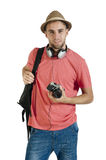 Young attractive tourist guy with camera and headphones isolated on white Royalty Free Stock Photo