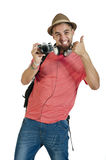 Young attractive tourist guy with camera and headphones isolated on white Stock Photography