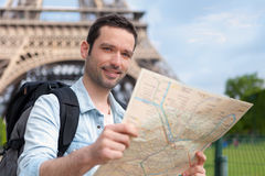Young attractive tourist reading map in Paris Stock Photos