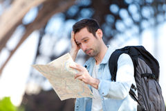 Young attractive tourist reading map in Paris Royalty Free Stock Photos