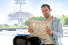 Young attractive tourist reading map in Paris. France Stock Images