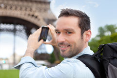 Young attractive tourist taking picture in Paris Stock Image