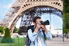 Young attractive tourist taking pictures in Paris Royalty Free Stock Photography