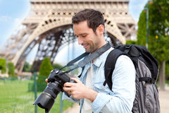 Young attractive tourist taking pictures in Paris Stock Photo